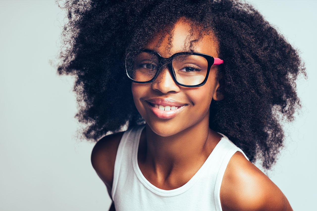 child wearing glasses smiling